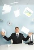 8432880-bureaucrat--a-businessman-juggling-documents-as-a-magician
